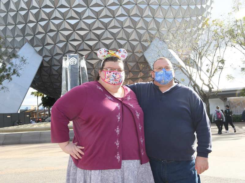 April and husband in front of Spaceship Earth