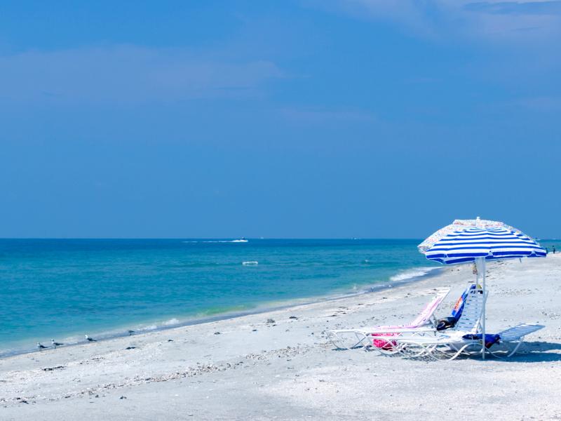 Sanibel Island Beach with sun chairs and umbrella