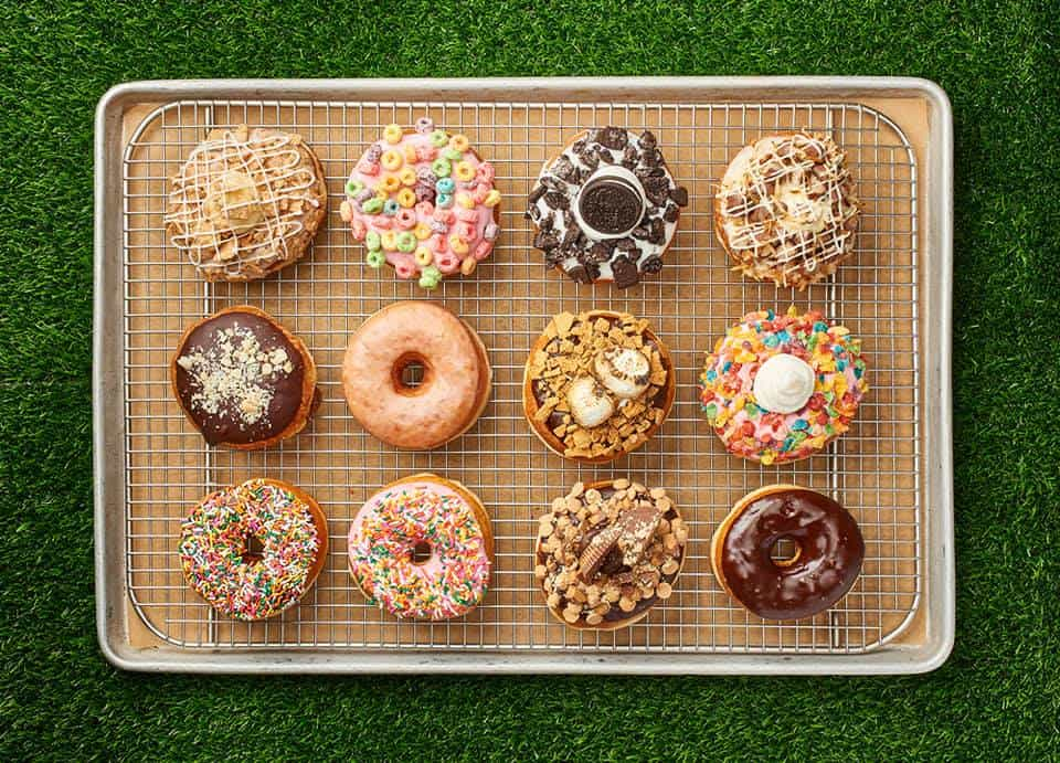 cookie sheet on astro turf with donuts on it